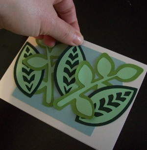 arranging leaves for Tropical Flowers Greeting Card