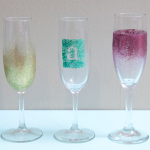 Champagne flutes with glitter embellishments